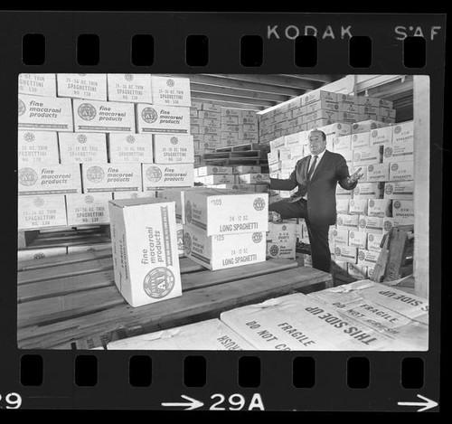 Calisphere: Pasta manufacturer Robert William, standing amid