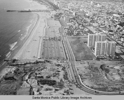 Looking north from the remains of the Pacific Ocean Park Pier to the Santa Monica Shores Apartments and Santa Monica, January 31, 1975, 2:30 PM