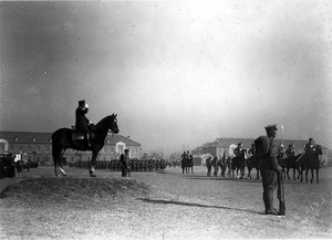Reviewing troops from horseback in Korea