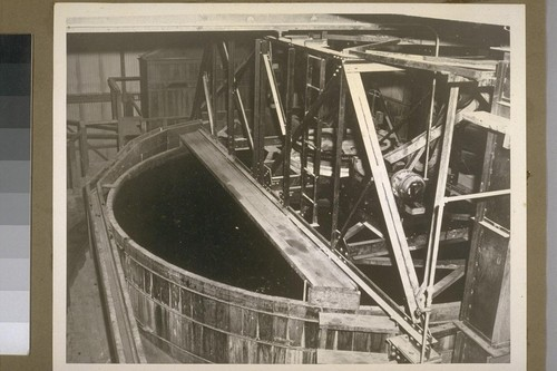 The first settling tank. The wood silt becomes water logged and goes to the bottom. The rubber floats, together with some cork, the latter being removed by forcing water into the air cells of the cork under 350 pounds pressure, which sinks in the settling tank. This picture is out of order, and should be in following the next two