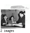 """Alien Japanese Taken into Custody--Among a group of alien Japanese taken into custody by Federal agents at Vallejo, Feb. 5 were Isekichi Matesuyama, 55, (left) and Michiko Ebiso, 49, (center), both laundry workers, shown being booked at the police station by Inspector Ralph Jensen. The pair are being held for immigration authorities.""--caption on photograph JARDA-1-39"