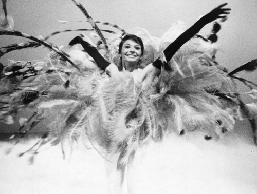 Woman dancer in feathers