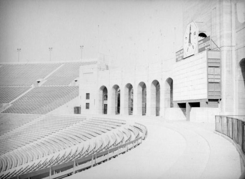 Coliseum arched entrance, timer, scoreboard and bleachers