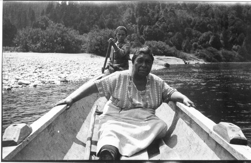 "Yurok grandmother in a ""double-ender"" canoe"