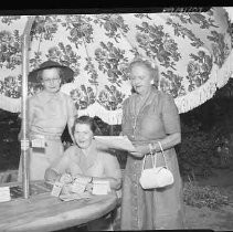 Three unidentified women at patio table
