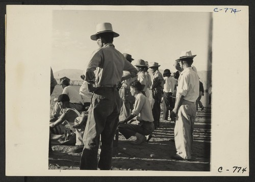 Manzanar, Calif.--Evacuees of Japanese ancestry are enjoying a baseball game at this War Relocation Authority center. This is a very