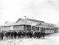 Petaluma Chamber of Commerce members at the Sebastopol Apple Growers Union packinghouse #3 with a special railroad car to Sebastopol on P&SR in connection with the Gravenstein Apple Show of 1920