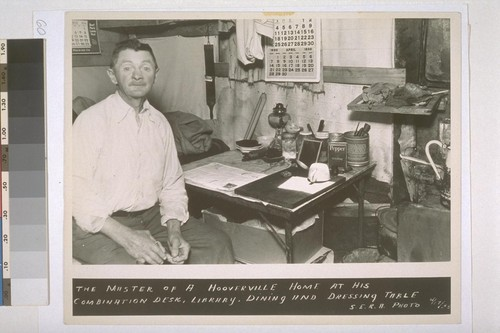 The master of a Hooverville home at his combination desk, library, dining and dressing table. S.E.R.A. Photo, 4/17/35
