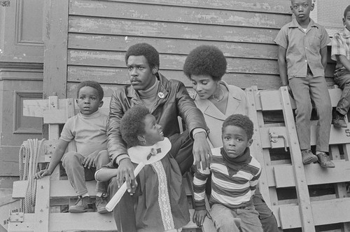 Captain David Hilliard, Chief of Staff of the Black Panther Party, with his family at a Free Huey Rally, Bobby Hutton Memorial Park, Oakland, CA, #82 from A Photographic Essay on The Black Panthers
