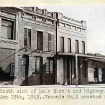 South side of Main [Sutter] Street and highway.. Folsom.. Jan 25th, 1943 .. Masonic Hall erected in 1857