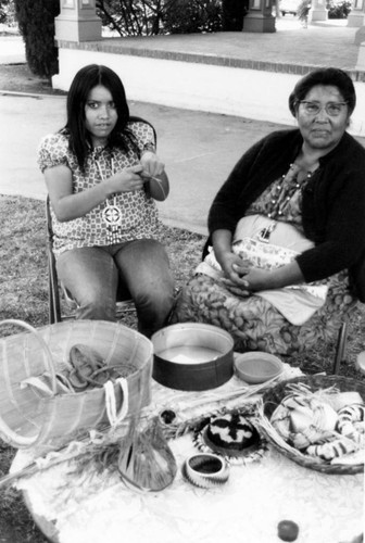 Rose Anderson with unidentified woman surrounded by baskets