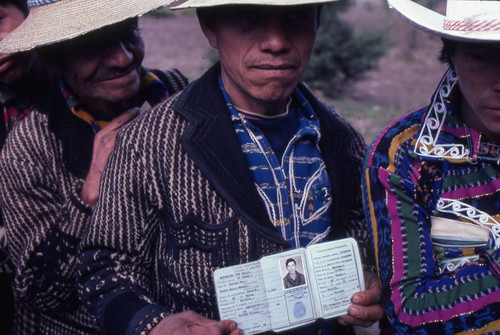 Mayan man showing his identification in line to vote, Sololá, 1982