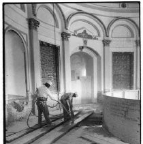 View of workers removing the rotunda railing from the California State Capitol building during the restoration project. The railing and other pieces will be stored until they are ready to be re-installed