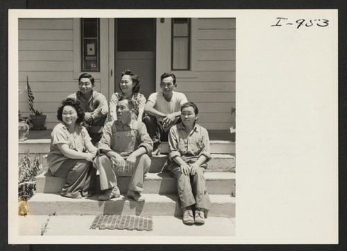 Seated on the steps of their home, the Doi family of Rt. 1, Box 53, Parlier, California, is shown left
