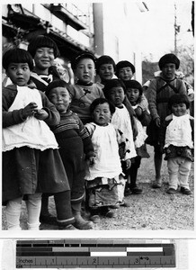 Group of children standing outdoors, Japan, ca. 1937
