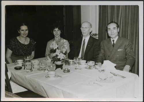 Mr. and Mrs. Polkinghorn with two individuals at a table