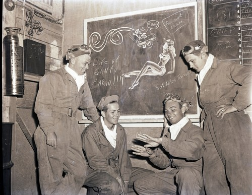 Cadets talking in the ready room, with pin-up doodle, Hancock College of Aeronautics