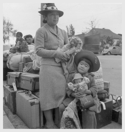 Hayward, Calif.--These people of Japanese ancestry are awaiting the special bus which will take them, and other evacuees, to the