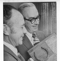 Richard H. Marriott, Mayor of Sacramento, 1968-1975. Here, Mayor Marriott (right) receives a horseshoe mounted on a plaque from Continental Can Co. executive John E. Gallagher
