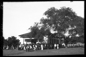 African people standing in front of the chapel, Chamanculo, Maputo, Mozambique, 1944