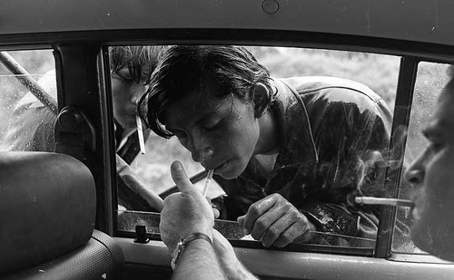 Photojournalist James Nachtwey lights a cigarette for a Sandinista boy, Nicaragua, 1979