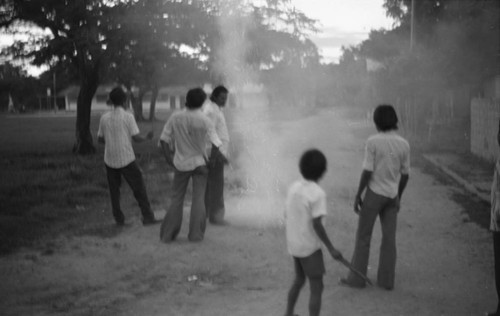 Boys playing with fireworks, La Chamba, Colombia, 1975