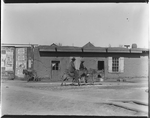 Santa Fe street scene, men on donkeys