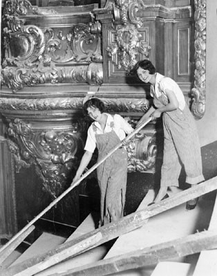 [Dorothy and Olga pose inside the Fox theater during its construction]