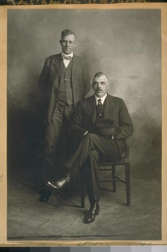 Det. Mike Burke [standing], S.F. [San Francisco] Police Dept., and Detective from Honolulu, 1920