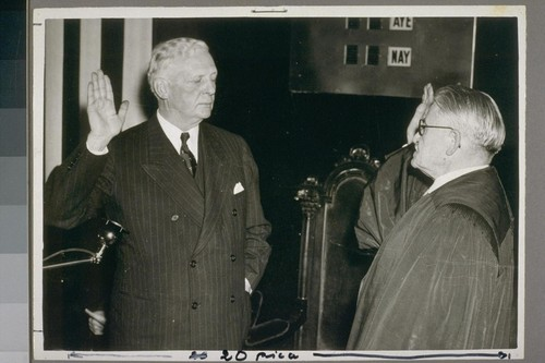New Executive Governor Culbert L. Olson (left), as he was sworn into office as the chief executive of the State of California by Associate Justice Emmett Seawell (right)