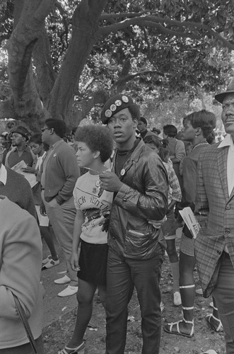 Black Panther couple listening, Free Huey Rally, DeFremery Park, Oakland, CA, #20 from A Photographic Essay on The Black Panthers