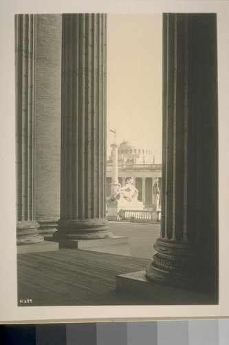 "H389. [Colonnade, Court of the Universe (McKim, Mead and White, architects. ""Fire"" (Robert I. Aitken, sculptor) and ""Fountain of the Rising Sun"" (Adolph A. Weinman, sculptor), in distance.]"