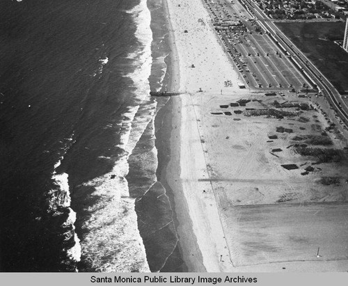 Looking north from the remains of the Pacific Ocean Park Pier to beach parking lots, June 25, 1975, 2:45 PM