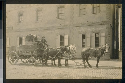 [D. Ghirardelli Company horse wagon outside factory.]