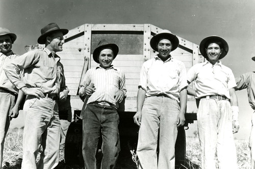 Robert Barr with four Mexican workers behind truck