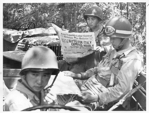 The Japanese-Americans who compose the 442nd combat team in training at Camp Shelby are keenly interested in daily news from