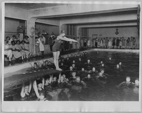 San Jose High School girls swimming in indoor pool [ca. 1940]