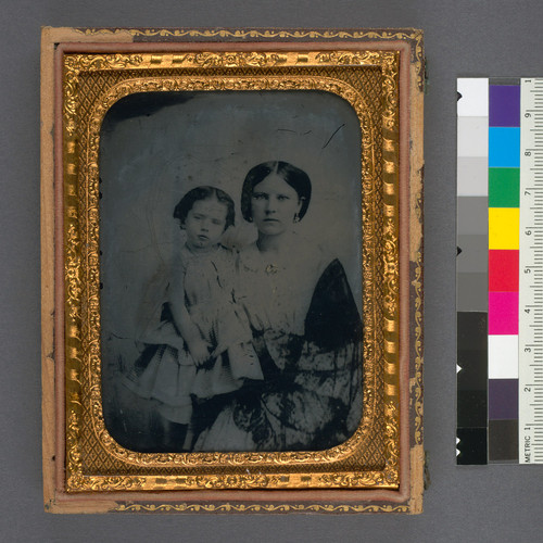 [Unidentified young mother and daughter.]