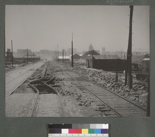 [Buckled streetcar tracks, South of Market St. Fourth St.?]