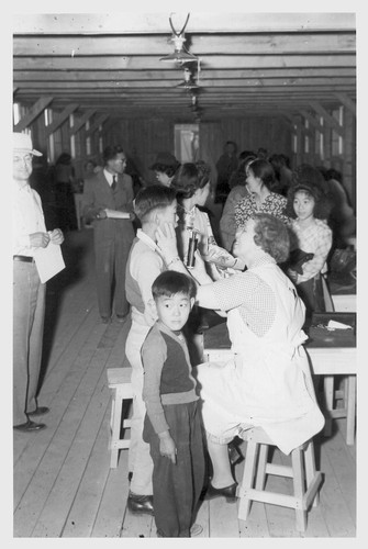 Poston, Ariz.--Evacuees of Japanese ancestry are given a preliminary medical examination upon arrival at this War Relocation Authority center.--Photographer: Clark, Fred--Poston, Arizona. 5/10/42