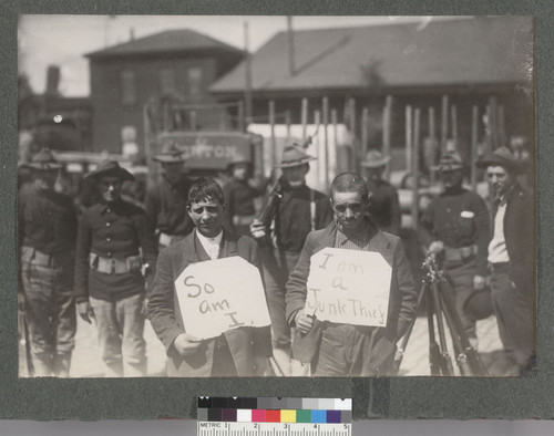 [Looters under guard of U.S. Army troops.]