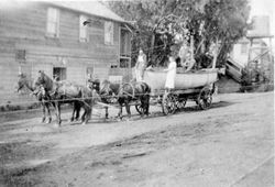 Four-horse drawn wagon hauling a lifeboat on Bodega Bay road in front of the Hotel, about 1908