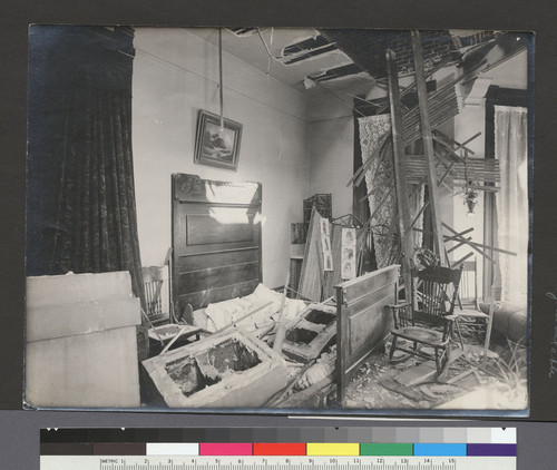 [Earthquake damage to residential interior.]