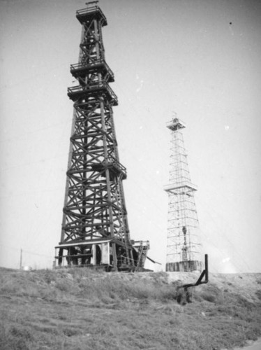 Two derricks in the Montebello oil field