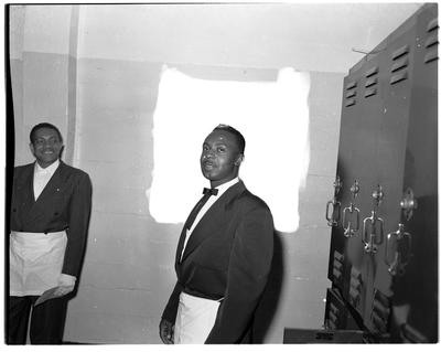 Calisphere: Two men wearing masonic aprons in locker room