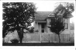 Unidentified man and woman in front of a west Sonoma County home, about early 1900s