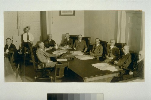 [Pardon hearing for Warren K. Billings. August 15, 1930. Left to right: court reporter, Warren K. Billings, Justice John Preston, court reporter, Chief Justice Waste, Justice Seawell, Justice Schenk, Justice Curtiss, Justice Langdon. Photograph by Howard Robbins. Glued to No. 02856b]