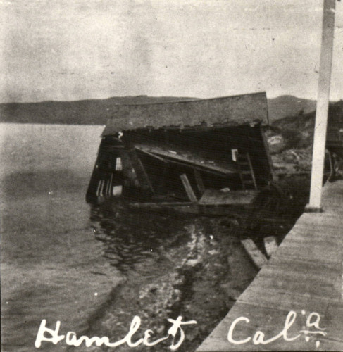 The railroad depot in Hamlet, on the east shore of Tomales Bay, thrown into the water during the earthquake of April 18, 1906, Marin County, California [photograph]