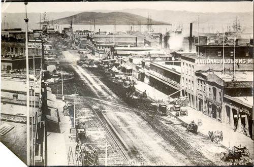 [View east down Market Street in 1865, with Yerba Buena Island in distance]