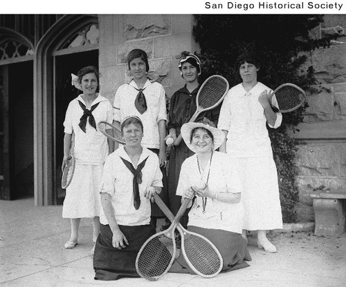 Members of a high school girls tennis team